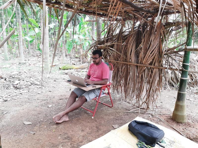 Vinayak Kallambi working under a hut.