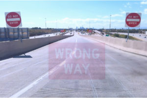 DO NOT ENTER AND WRONG WAY SIGNS AT A HIGHWAY EXIT
