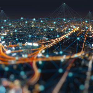 Busy city at night connected by the internet