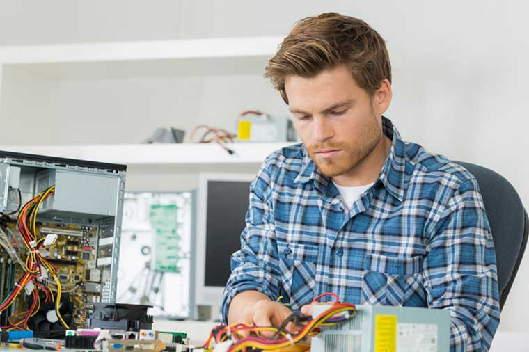 Engineer making repairs to a computer.