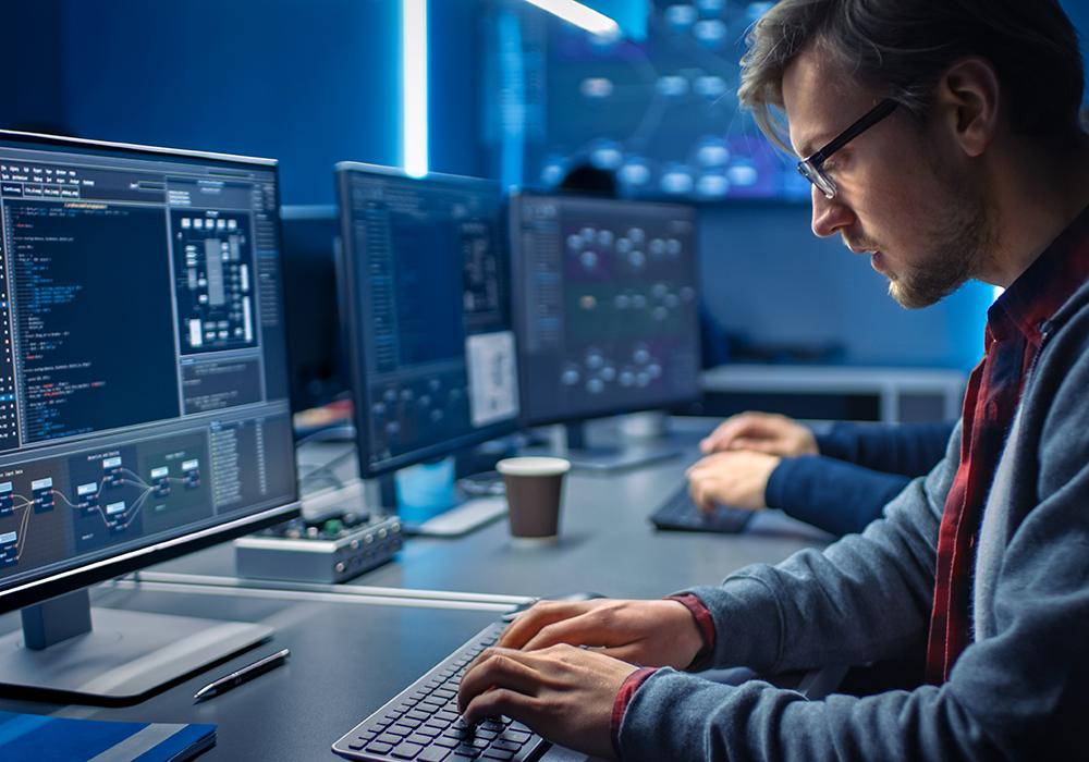 Data analyst working on desktop computer in data center