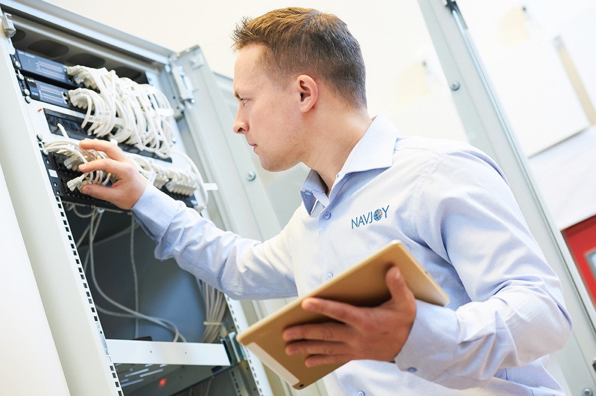 Network engineer working on a panel