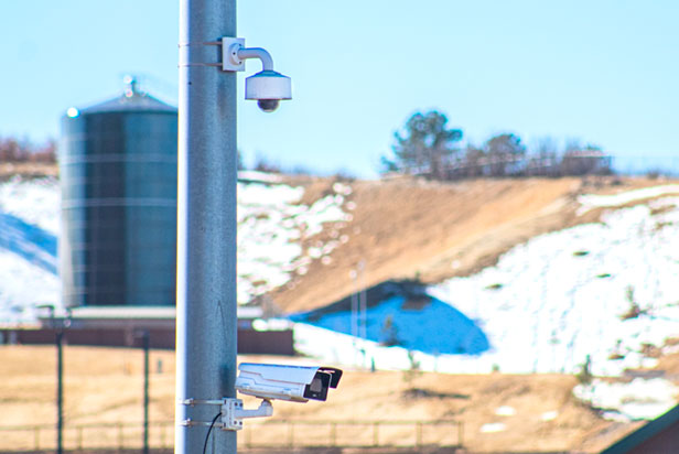 Cameras on the side of a traffic pole collecting interstate traffic data.