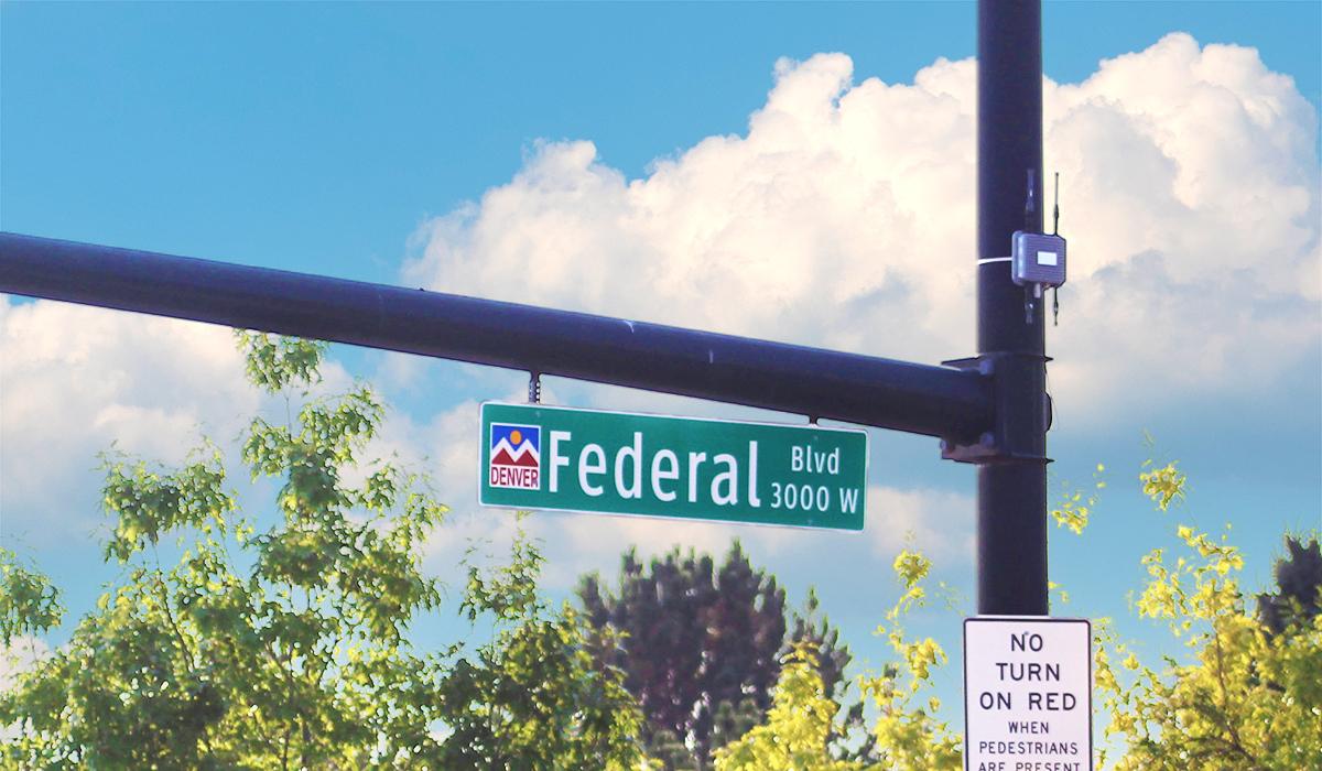 Bluetooth device on traffic signal pole in Denver, Colorado.