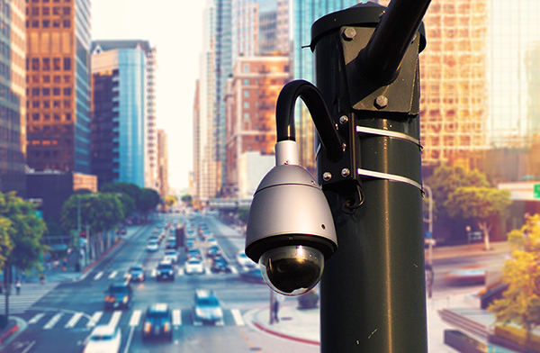 Traffic camera over city street.