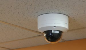 Bosch camera attached to tiles in ceiling.