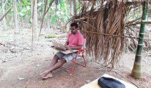 Navjoy employee working remotely from a nut farm