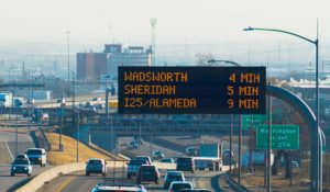 Dynamic message board displaying travel times on I-25 in Denver, Colorado