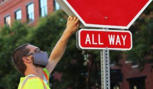 Navjoy employee assesses a stop sign