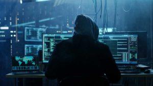 Hacker at a computer.