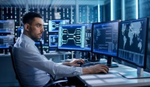 Networking security specialist working in an operations center.
