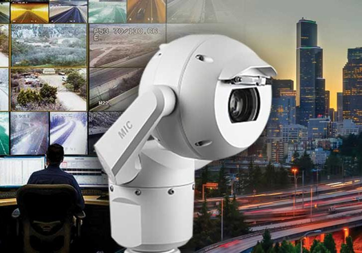 Bosch camera against backdrop of display screens and city traffic